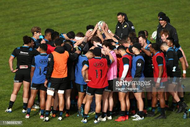 Players form a huddle during a Hurricanes Super Rugby training session at Rugby League Park on June 18 2019 in Wellington New Zealand
