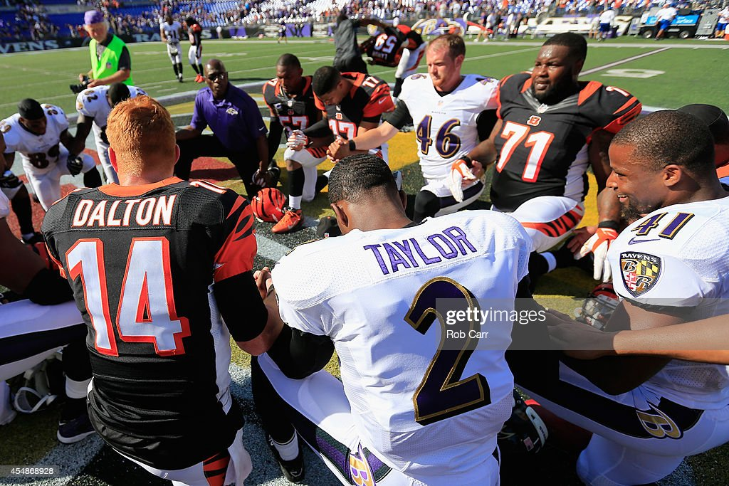 Players form a prayer circle after the Cincinnati Bengals defeated the Baltimore Ravens 23-16 during an NFL football game at M&T Bank Stadium on September 7, 2014 in Baltimore, Maryland.