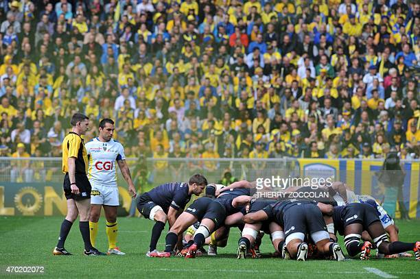 Players form a ruck during the European Rugby Champions Cup semi-final match between Clermont and Saracens at Geoffroy-Guichard stadium in...