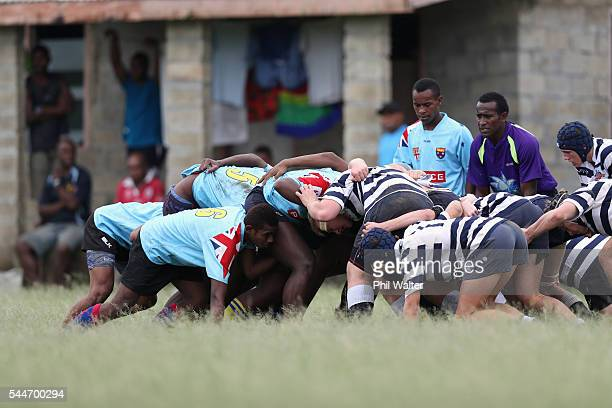 Players form a scrum during the Fiji Schoolboy Rugby match between St Stanislaus College and Andhra Secondary School on July 2 2016 in Nadi Fiji