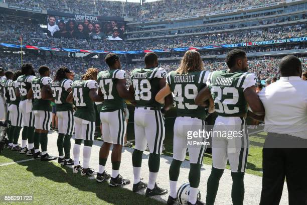 Players form the New York Jets lock arms in unity before the game against the Miami Dolphins on September 24 2017 at MetLife Stadium in East...