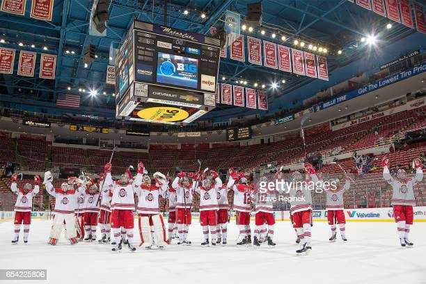 Players form the Ohio State Buckeyes salute the fans after defeating the Michigan State Spartans 63 in game one of the Big Ten Men's Ice Hockey...
