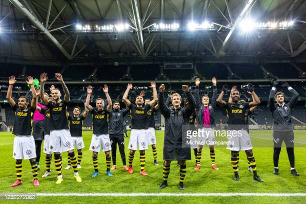 Players from AIK celebrate their victory in front of the 8 supporters who attended the match during an Allsvenskan match between AIK and Degerfors IF...