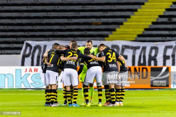 Players from AIK huddle together during the Allsvenskan match between AIK and IFK Goteborg at Friends Arena on October 18, 2020 in Stockholm, Sweden.