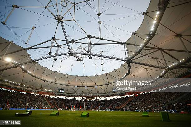 Players from Argentina warm up as fans cheer in the tribunes prior to the kick-off of the match between Argentina Los Pumas and New Zealand All...