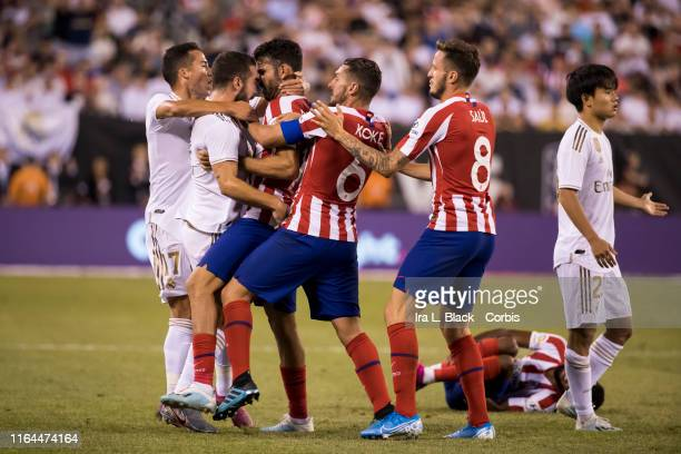 Players from Atletico de Madrid and Real Madrid try to stop Daniel Carvajal of Real Madrid and Diego Costa of Atletico Madrid from getting into a...
