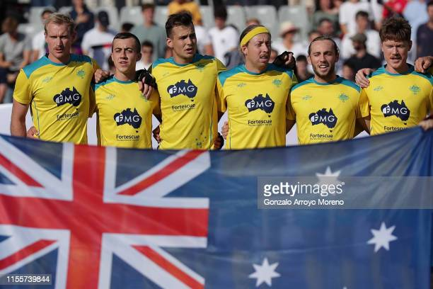 Players from Australia listen to their national anthem before the Men's FIH Field Hockey Pro League match between Spain and Australia at Club Villa...