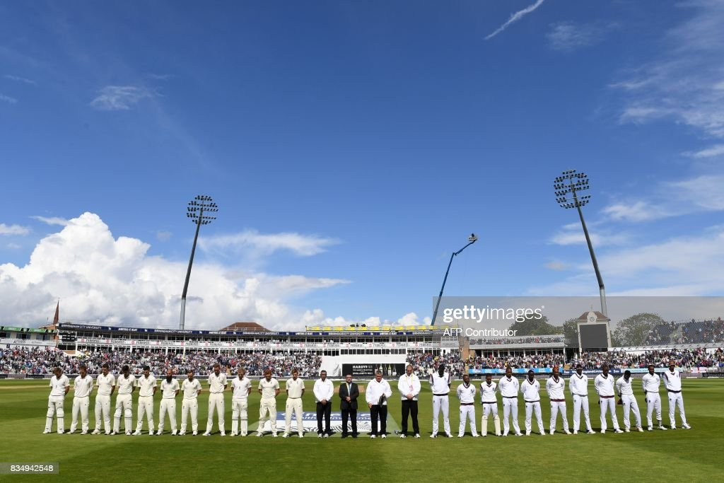 Players from both sides and officials observe a minute's silence for the victims of yesterday's terror attacks in Barcelona and Cambrils in Spain, ahead of play on day 2 of the first Test cricket match between England and the West Indies at Edgbaston in Birmingham, central England on August 18, 2017. Spanish police on Friday hunted for the driver who rammed a van into pedestrians on an avenue crowded with tourists in Barcelona, leaving 13 people dead and more than 100 injured, just hours before a second assault in a resort along the coast. PHOTO / Paul ELLIS / RESTRICTED