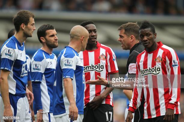 Players from both sides argue a decision by referee Phil Dowd