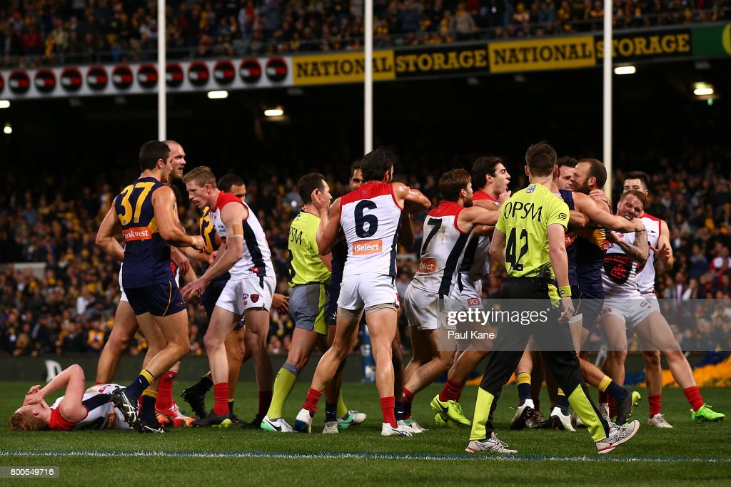 Players from both sides become involved in a melee after incident between Will Schofield of the Eagles and Clayton Oliver of the Demons during the round 14 AFL match between the West Coast Eagles and the Melbourne Demons at Domain Stadium on June 24, 2017 in Perth, Australia.