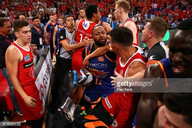 Players from both sides become involved in a melee during the round 17 NBL match between the Perth Wildcats and the Adelaide 36ers at Perth Arena on...
