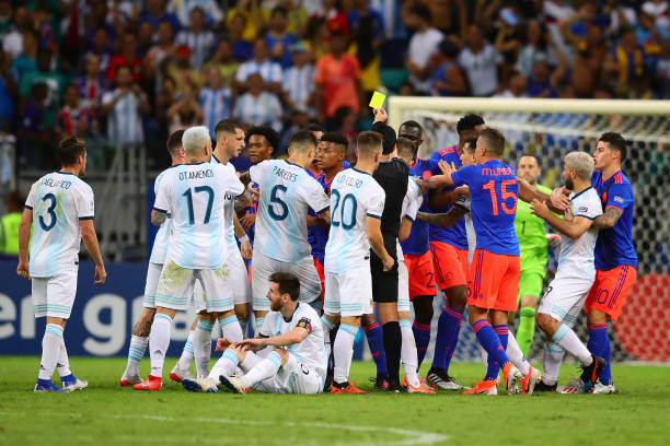 Players from both sides clash during the Copa America Brazil 2019 group B match between Argentina and Colombia at Arena Fonte Nova on June 15 2019 in...
