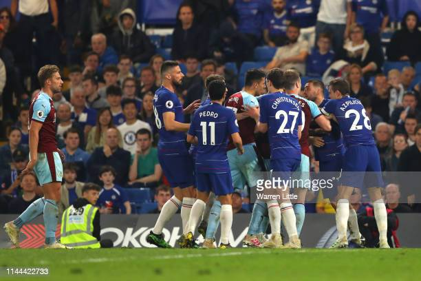 Players from both sides clash during the Premier League match between Chelsea FC and Burnley FC at Stamford Bridge on April 22 2019 in London United...