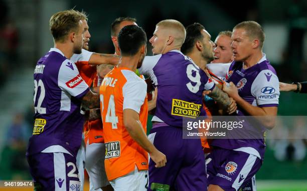 Players from both sides come together in scuffle in the second half during the round 27 ALeague match between the Perth Glory and the Brisbane Roar...