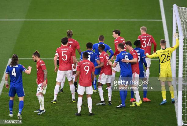 Players from both side's including Harry Maguire, Anthony Martial, Aaron Wan-Bissaka, Nemanja Matic and Dean Henderson of Manchester United and Youri...