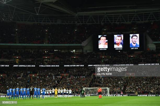 TOPSHOT Players from both sides observe a minute of applause for Jimmy Armfield Cyrille Regis and Davide Astori ahead of the International friendly...