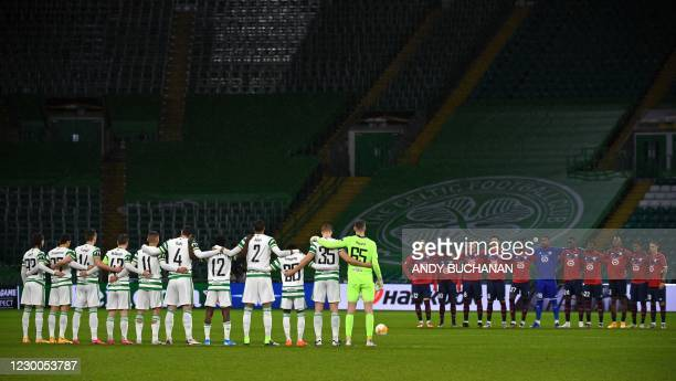 Players from both sides observe a minute of silence as they pay their respects to the former Italian international Paolo Rossi ahead of the UEFA...