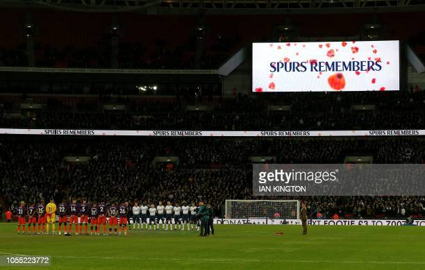 Players from both sides observe a minute's silence for Remembrance Day and also for the victims of the helictopter that crashed outside Leicester...