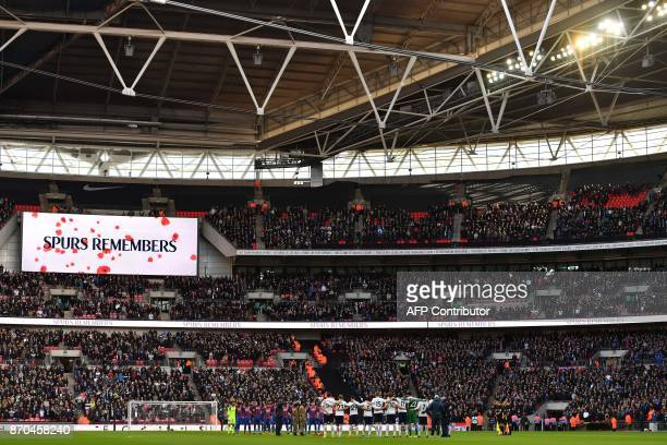 Players from both sides observe a minute's silence for Remembrance Day ahead of the English Premier League football match between Tottenham Hotspur...