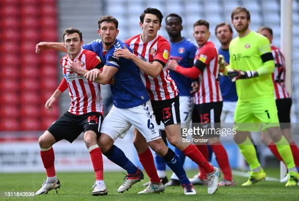 Players from both sides push and pull whilst waiting for a corner kick to reach them during the Sky Bet League One match between Sunderland and...