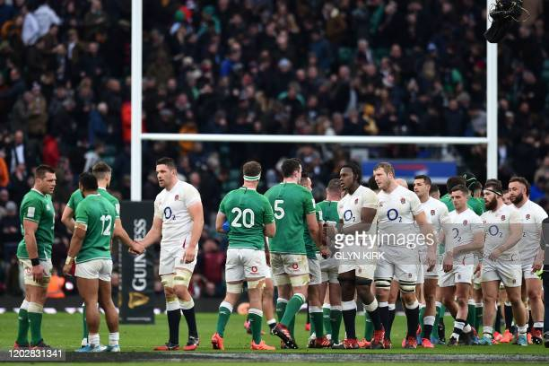 Players from both sides shake hands after the Six Nations international rugby union match between England and Ireland at the Twickenham west London...