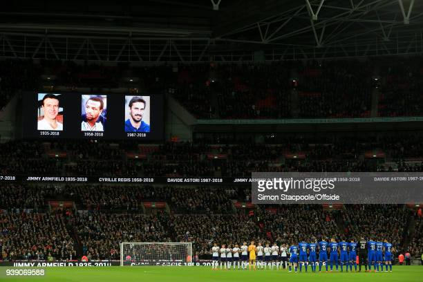 Players from both sides take a moment to applaud the late Jimmy Armfield Cyrille Regis and Davide Astori before the international friendly match...