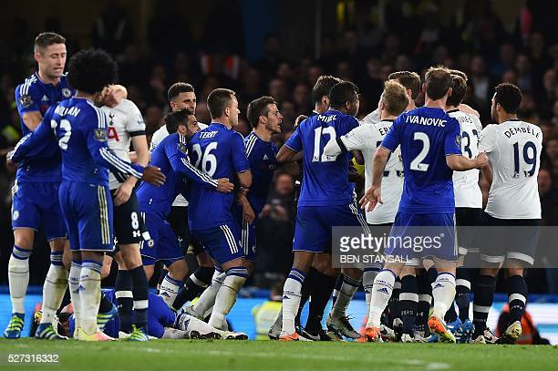 Players from both teams clash during the English Premier League football match between Chelsea and Tottenham Hotspur at Stamford Bridge in London on...