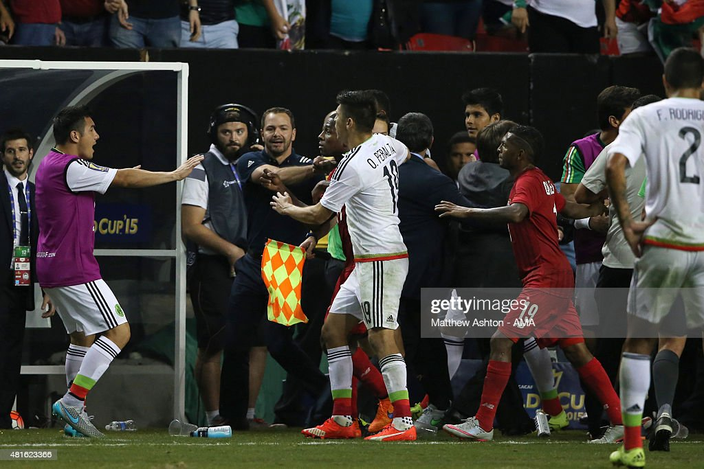 Players from both teams confront each other after a last minute penalty was awarded to Mexico in the last minute of the 2015 CONCACAF Gold Cup Semi Final between Panama and Mexico at Georgia Dome on July 22, 2015 in Atlanta, Georgia.