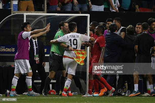 Players from both teams confront each other after a last minute penalty was awarded to Mexico in the last minute of the 2015 CONCACAF Gold Cup Semi...