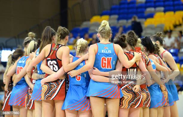 Players from both teams embrace after the round seven Australian Netball League match between the Storm and the Waratahs at University of the...