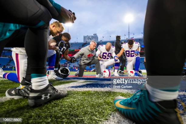 Players from both teams join hands in prayer at center field after the game between the Buffalo Bills and the Jacksonville Jaguars at New Era Field...