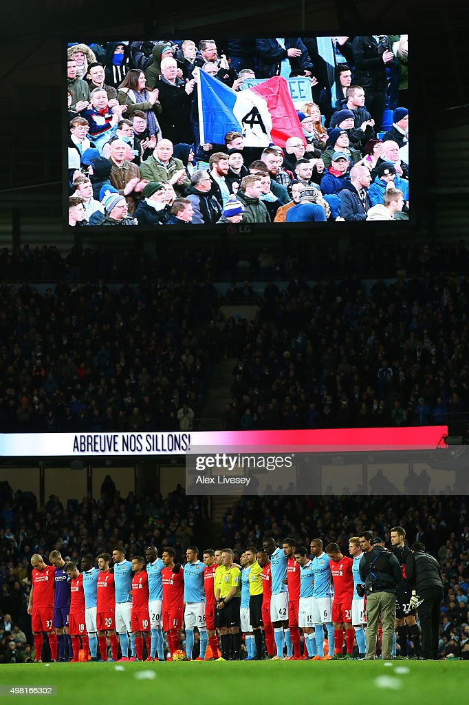 Players from both teams line up for the French national anthem to remember the victims of the terror attacks in Paris last week prior to the Barclays Premier League match between Manchester City and Liverpool at Etihad Stadium on November 21, 2015 in Manchester, England.