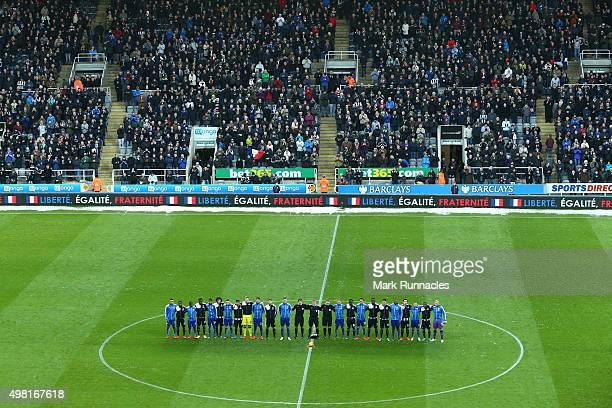 Players from both teams line up for the French national anthem to remember the victims of the terror attacks in Paris last week prior to the Barclays...