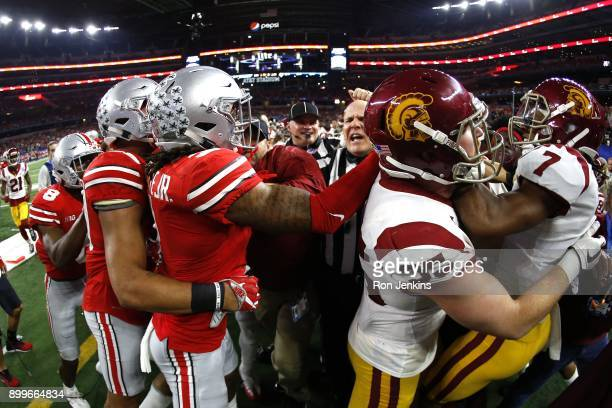 Players from both teams participate in a skirmish in the second half of the 82nd Goodyear Cotton Bowl Classic between USC and Ohio State at ATT...