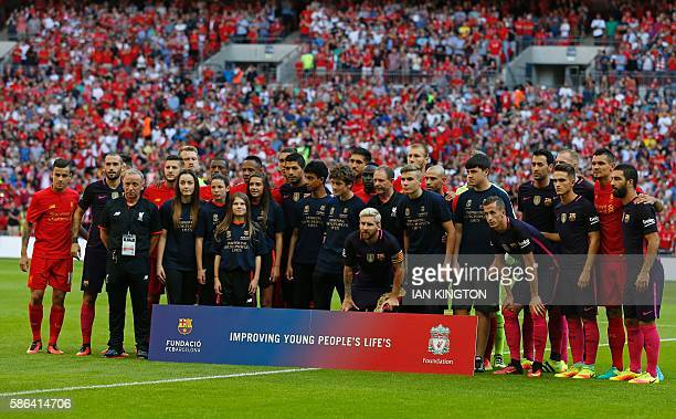 Players from both teams pose for a group photograph ahead of the preseason International Champions Cup football match between Spanish champions...