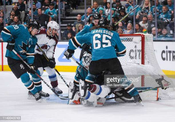 Players from both teams scramble in front of the net for the puck in the third period during the Stanley Cup Playoffs game between the San Jose...