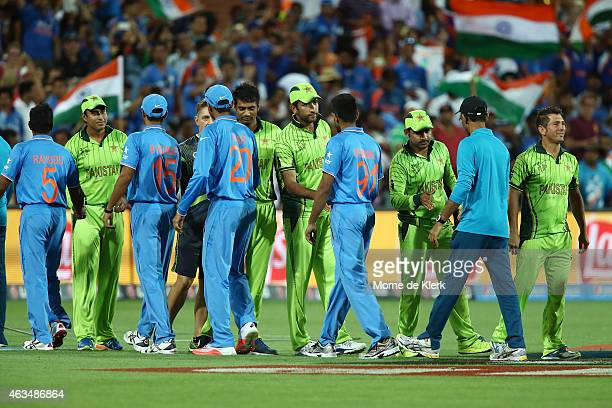 Players from both teams shake hands after the 2015 ICC Cricket World Cup match between India and Pakistan at Adelaide Oval on February 15, 2015 in...