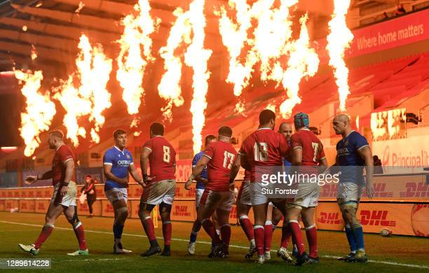 Players from both teams shake hands as the flames go off after the Autumn Nations Cup match between Wales and Italy at Parc y Scarlets on December...