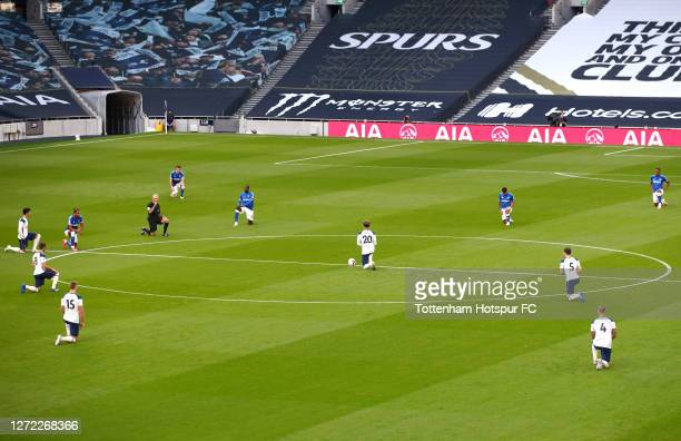 Players from both teams take a knee in support of the Black Lives Matter movement prior to the Premier League match between Tottenham Hotspur and...