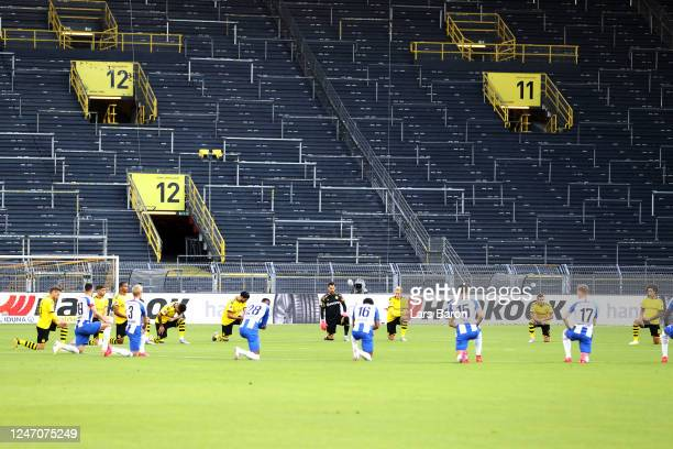 Players from both teams take a knee prior to the Bundesliga match between Borussia Dortmund and Hertha BSC at Signal Iduna Park on June 06 2020 in...