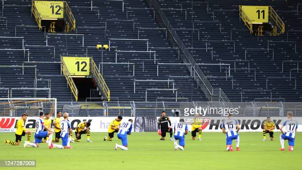 Players from both teams take a knee prior to the Bundesliga match between Borussia Dortmund and Hertha BSC at Signal Iduna Park on June 06, 2020 in...