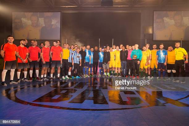 Players from Brazil and Australia pose for a photo with Futsal players during the Nike 'No Turning Back' Fan Meet Greet at Hangar 85 on June 10 2017...