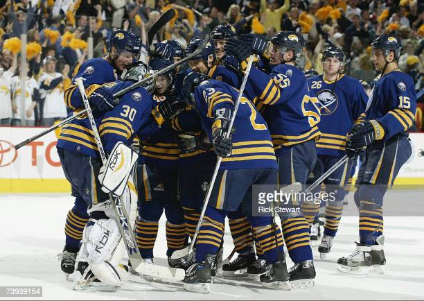 Players from Buffalo Sabres celebrate with their goalie Ryan Miller after defeating the New York Islanders in Game 5 of the 2007 NHL Eastern...