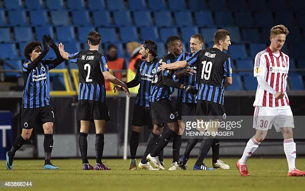Players from Club Brugge celebrate after scoring during Aalborg BK v Club Brugge KV during UEFA Europa League Round of 32 on February 19, 2015 in...