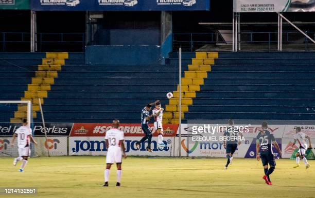 Players from Club Sport Cartaguines and Liga Deportiva Alajuelense go for the ball at the Rafael Fello Meza stadium in Cartago, Costa Rica, May 19,...