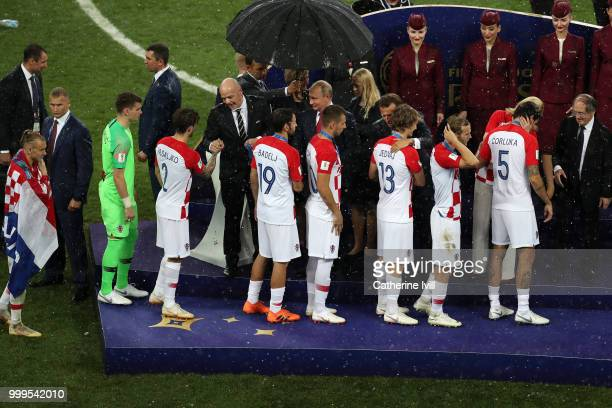 Players from Croatia are presented with their runner up medals following the 2018 FIFA World Cup Final between France and Croatia at Luzhniki Stadium...