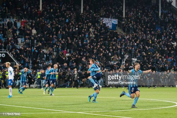 Players from Djurgardens IF celebrate after the final whistle and their win of the 2019 Allsvenskan season during an Allsvenskan match between IFK...