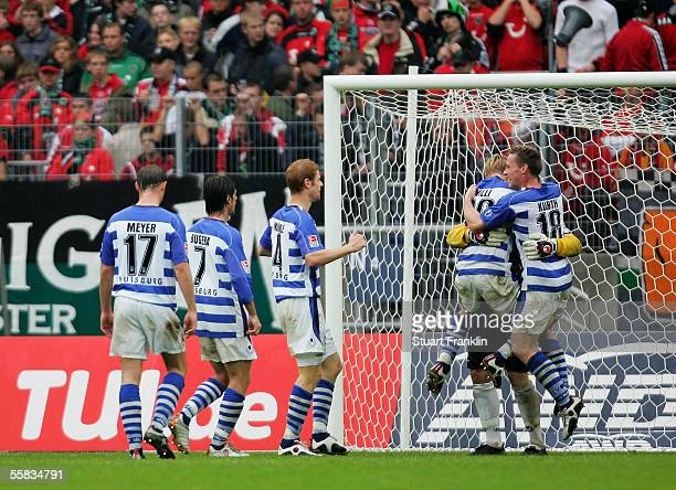 Players from Duisburg celebrate at the end of the Bundesliga match between Hannover 96 and MSV Duisburg at the AWD Arena on October 1 2005 in...