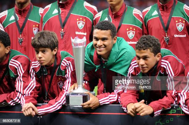 Players from Fluminense FC in Brazil parade the Manchester United Premier Cup in front of the fans