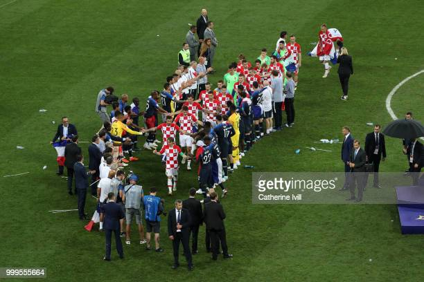 Players from France give Croatia players a guard of honor as they prepare to go to the podium to collect their runner up medals following the 2018...